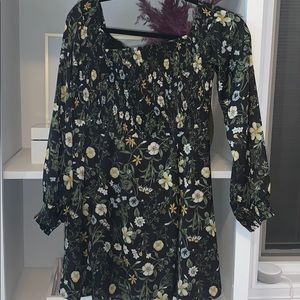 Floral dress with long sleeves.Greenish undertones